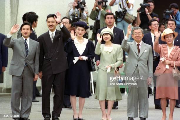 Crown Prince Naruhito Prince Akishino Princess Kiko of Akishino Princess Sayako Prince Hitachi and Princess Hanako of Hitachi wave to Emperor Akihito...