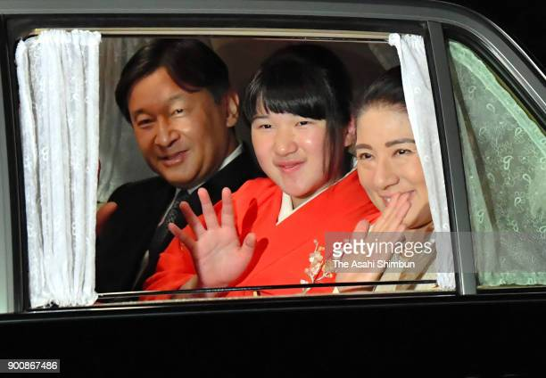 Crown Prince Naruhito Princess Aiko and Crown Princess Masako wave to media reporters on arrival at the Imperial Palace on January 2 2018 in Tokyo...