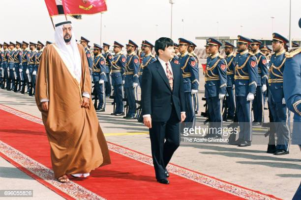 Crown Prince Naruhito reviews the honour guard along with Crown Prince Khalifa bin Zayed Al Nahyan of the UAE on arrival at Abu Dhabi Airport on...