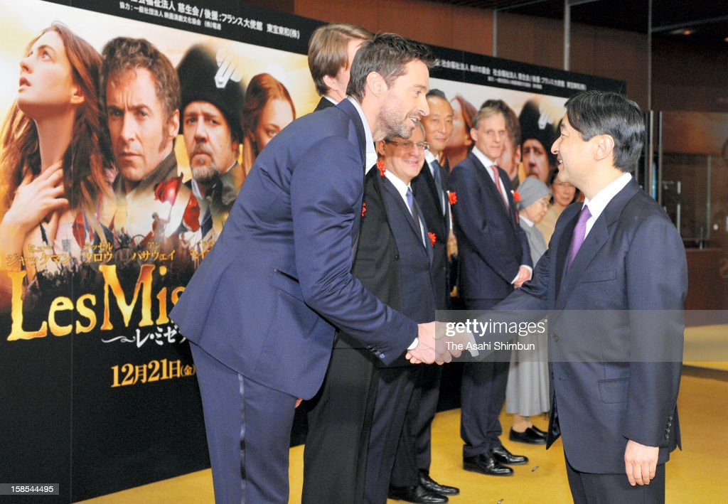 Crown Prince Naruhito (R) shakes hands with actor Hugh Jackman during the 'Les Miserables' charity premiere on December 18, 2012 in Tokyo, Japan.