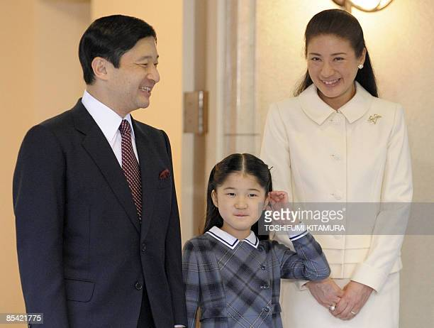 Crown Prince Naruhito shares a light moment with his daughter Princess Aiko and Crown Princess Masako prior to his departure for Turkey at his...
