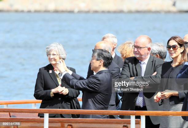 Crown Prince Naruhito takes photographs while cruising around Copenhagen Harbour with Crown Princess Mary of Denmark on June 20 2017 in Copenhagen...