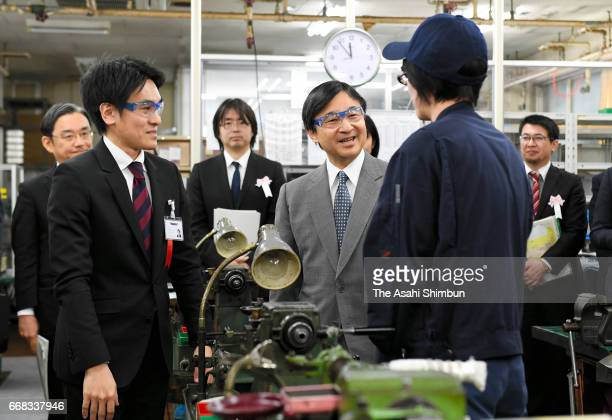 Crown Prince Naruhito talks to staffs during his visit to precision equipment maker Yuki Precision on March 8, 2017 in Chigasaki, Kanagawa, Japan.