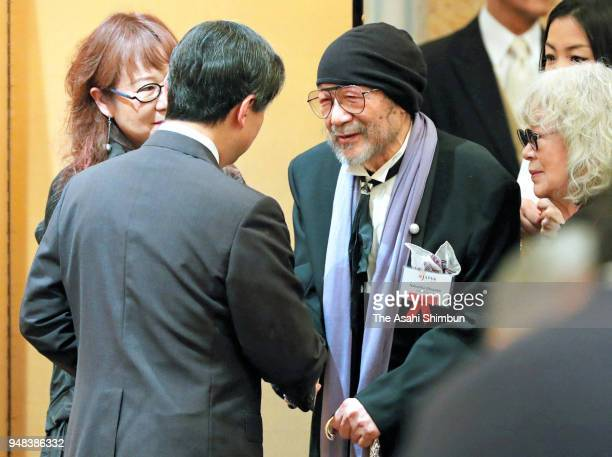 Crown Prince Naruhito talks with film director Nobuhiko Obayashi during the reception of the 110th Anniversary ceremony of the Japan Society...
