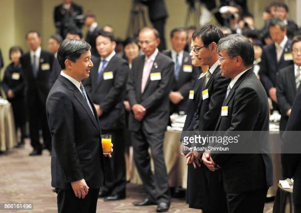 Crown Prince Naruhito talks with guests during the reception of the yong farmers summit on October 23 2017 in Kochi Japan