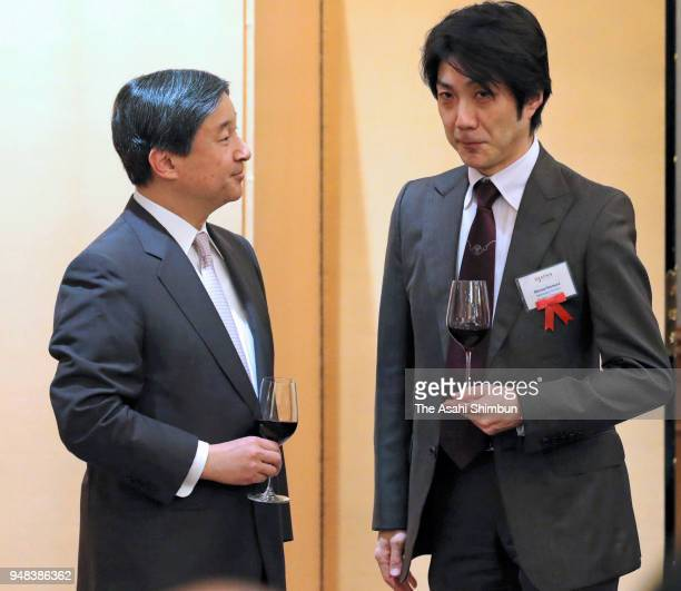 Crown Prince Naruhito talks with Kyogen actor Mansai Nomura during the reception of the 110th Anniversary ceremony of the Japan Society foundation on...
