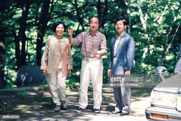 Crown Prince Naruhito talks with writer Kunio Tsuji and his wife on August 10 1992 in Karuizawa Nagano Japan