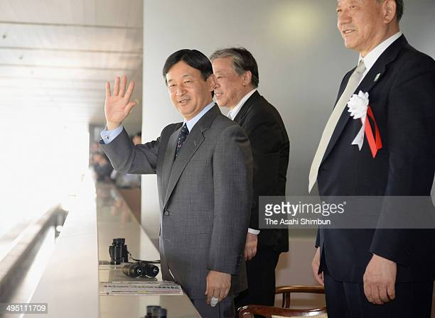 Crown Prince Naruhito waves as he attends the Japan Derby at Tokyo Racecourse on June 1 2014 in Fuchu Tokyo Japan