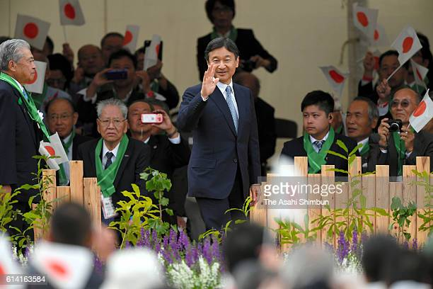 Crown Prince Naruhito waves to participants on arrival at the National Tree Growing Festival on October 9 2016 in Nantan Kyoto Japan