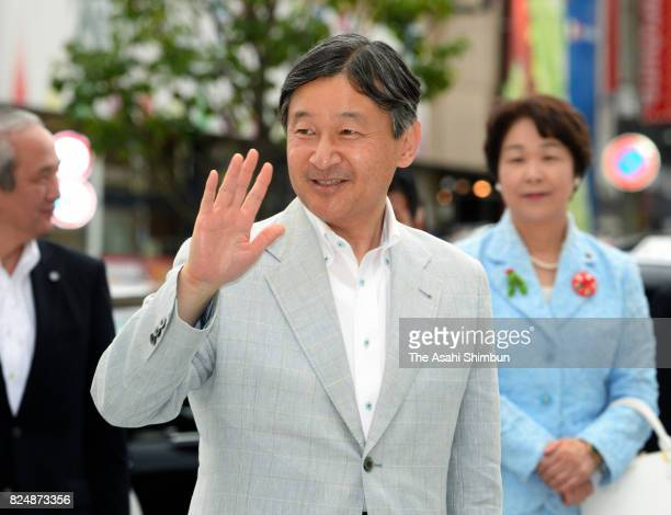 Crown Prince Naruhito waves to wellwishers on arrival at Yamagata Station on July 29 2017 in Yamagata Japan