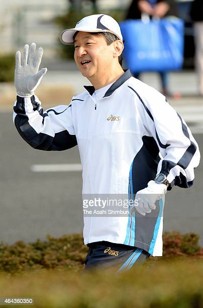 Crown Prince Naruhito waves to wellwishers while jogging around the Imperial Palace on February 25 2015 in Tokyo Japan The crown prince usually jogs...