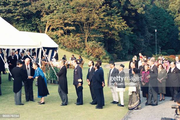 Crown Prince Naruhito welcomes guests during the garden party celebrating Emperor Akihito's Enthronement at the Akasaka Imperial Garden on November...