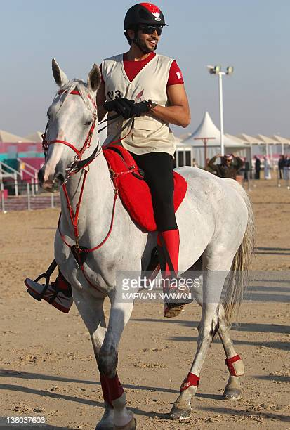 Crown Prince of Bahrain Sheikh Nasser bin Hamad alKhalifa prepares to take part in the Arab Games' 120 kms endurance competition near Doha Qatar on...