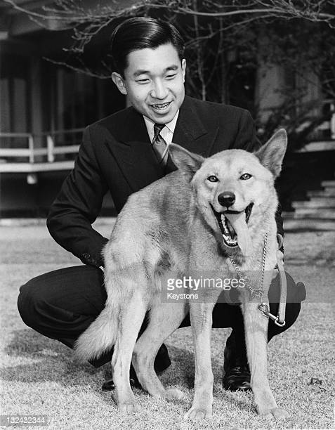 Crown Prince of Japan, Akihito with his pet dog Dingo in the grounds of Togu Palace, his residence in Tokyo, December 1963.