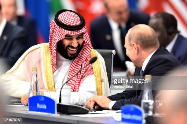 Crown Prince of Saudi Arabia Mohammad bin Salman al-Saud shares a laugh with Russian President Vladimir Putin during the opening day of Argentina G20...