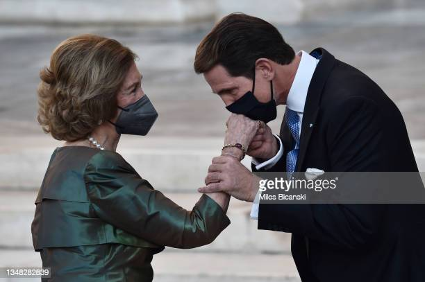 Crown Prince Pavlos of Greece greets Queen Sofia of Spain following the wedding ceremony for Nina Flohr and Prince Philippos at the Metropolis Greek...