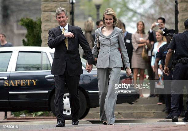 Crown Prince Philippe of Belgium and Crown Princess Mathilde walk through the streets after visiting Georgetown University April 19, 2005 in...