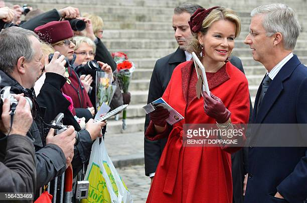 Crown Prince Philippe of Belgium and Princess Mathilde of Belgium meet people after the Te Deum mass on the occasion of the King's Feast at the Saint...
