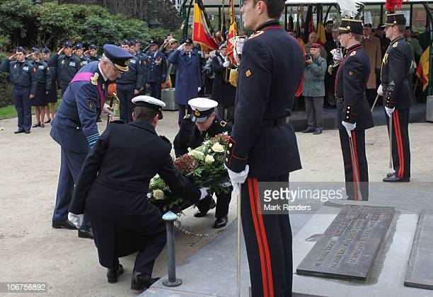 Crown Prince Philippe of Belgium lays a floral wreath at the Thomb of the Unknown Soldier on Armistice Day on November 11 2010 in Brussels Belgium