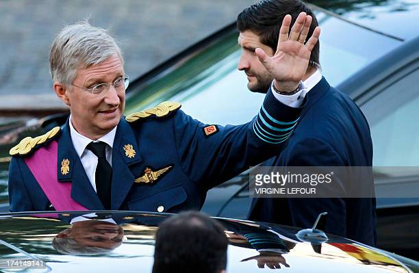 Crown Prince Philippe of Belgium waves after attending the Te Deum mass on the occasion of Belgian National Day at the Saint Michael and St Gudula...