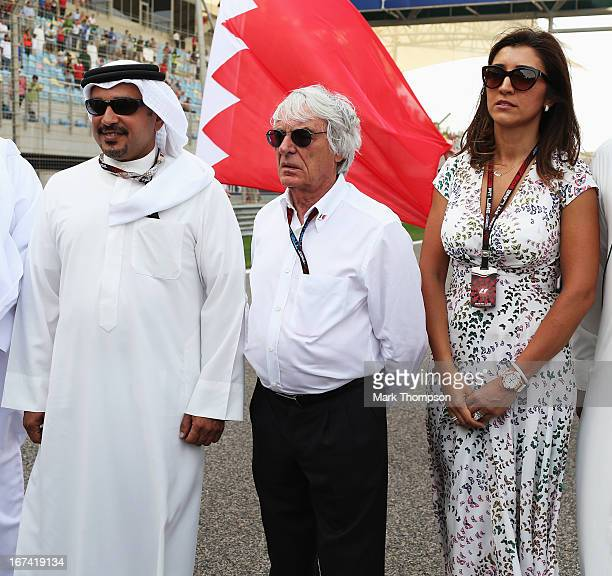 Crown Prince Shaikh Salman bin Isa Hamad Al Khalifa, F1 supremo Bernie Ecclestone and his wife Fabiana FlosI on the grid before the Bahrain Formula...
