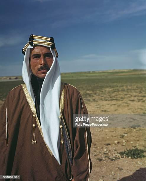 Crown Prince Talal of Jordan son of Abdullah King of Jordan pictured wearing a white keffiyeh and gold agal in Amman Jordan in April 1948
