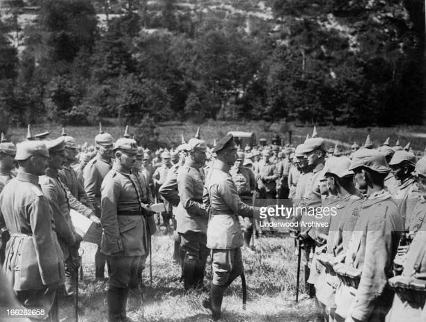 Crown Prince Wilhelm of Germany awarding troops with the Iron Cross at an outdoor thanksgiving service in the Argonne forest southeast of Lancon,...