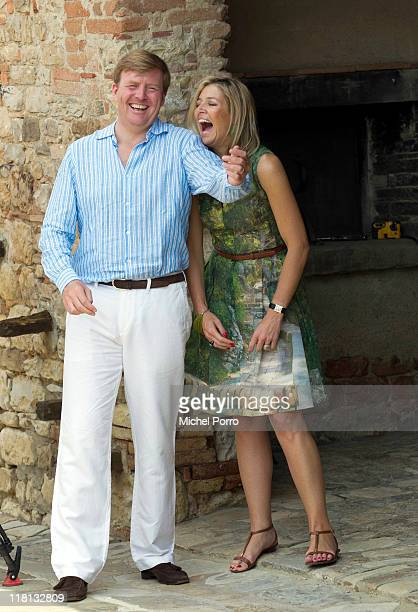 Crown Prince WillemAlexander and Princess Maxima of the Netherlands laugh during a photo session on July 4 2011 in Tavernelle Italy