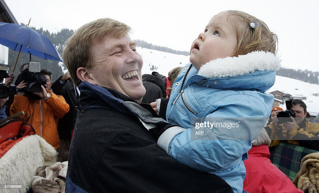 Crown Prince Willem-Alexander (L) holds his daughter Princess Amalia at the Austrian winter sport resort Lech, 12 February 2005. Dutch Queen Beatrix celebrates the winter holiday with her son, daughter in law and her grandchild in Lech.