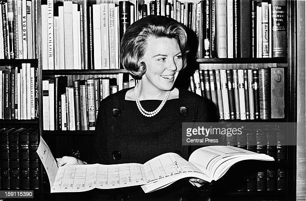 Crown Princess Beatrix, later Queen Beatrix of the Netherlands, holding the programme for the 1964 Summer Olympics in her office, Netherlands, 27th...