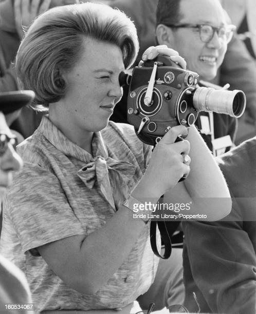 Crown Princess Beatrix of the Netherlands films a cycling event during the Olympic Games in Tokyo 18th October 1964