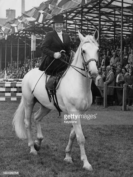 Crown Princess Beatrix of the Netherlands leading the Dutch Horse Club parade during a horse show in Utrecht, 14th September 1961.