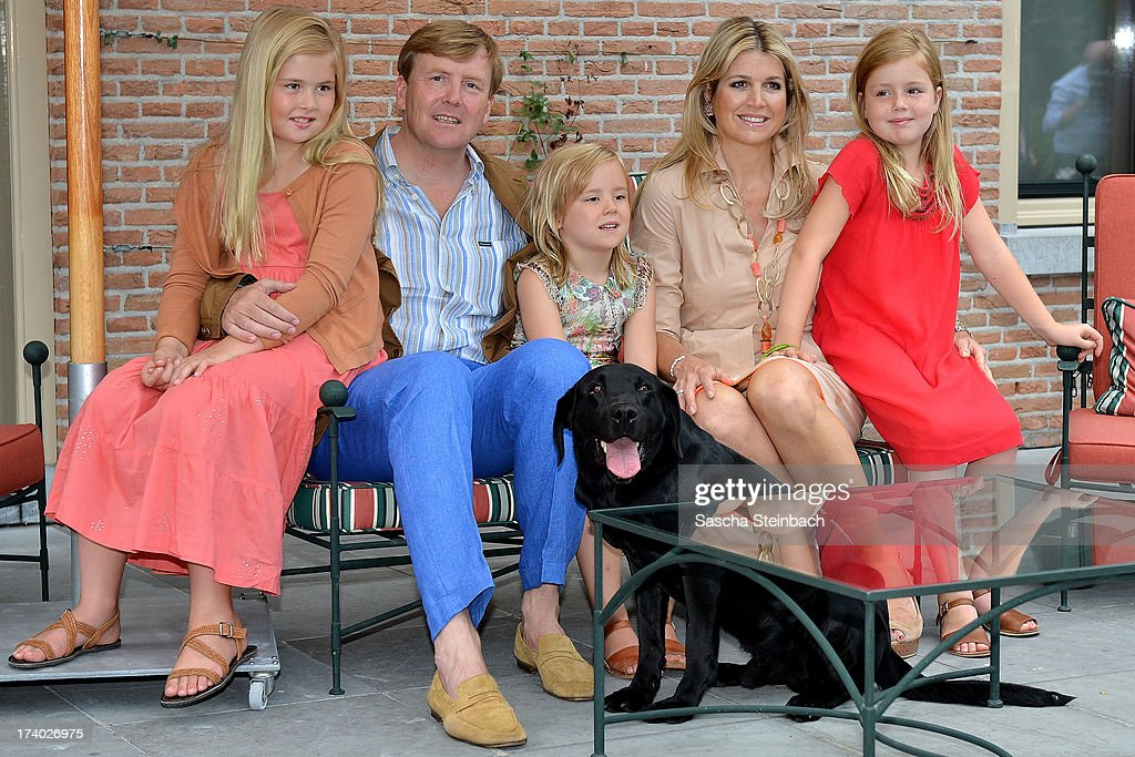 Crown Princess Catharina-Amalia of the Netherlands, King Willem-Alexander of the Netherlands, Princess Ariane of the Netherlands, Queen Maxima of the Netherlands and Princess Alexia of the Netherlands pose with their dog 'Skipper' during the annual summer photocall at Horsten Estate on July 19, 2013 in Wassenaar, Netherlands.