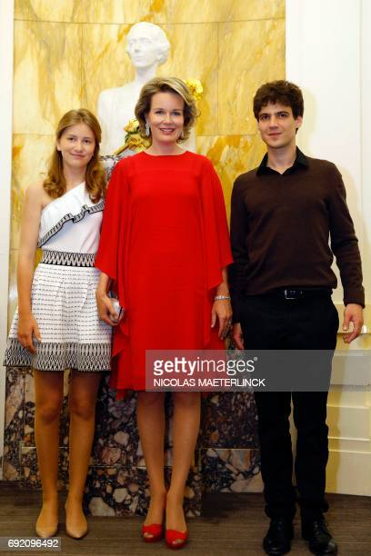 Crown Princess Elisabeth and Queen Mathilde of Belgium pose with winner of the Queen Elisabeth Competition French cellist Victor JulienLaferriere...