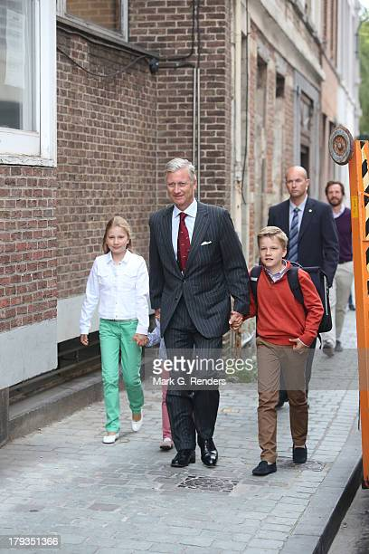 Crown Princess Elisabeth King Philippe and Prince Gabriel of Belgium arrive for the first day of school at the SintJanBerchmans College on September...