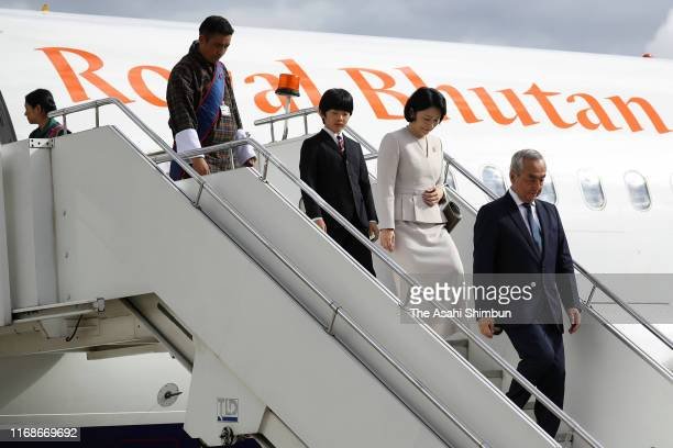 Crown Princess Kiko of Akishino and Prince Hisahito of Japan are seen on arrival at Paro International Airport on August 17 2019 in Paro Bhutan