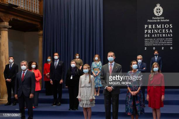 Crown Princess Leonor of Spain , King Felipe VI , Queen Letizia and Princess Sofia pose with the 2020 Princess of Asturias Awards honorees during an...