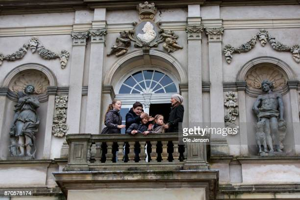 Crown Princess Mary and children at the Hermitage hunting lodge balcony during the yearly Hubertus Hunt at The Woodland Park 'Dyrehaven' on November...