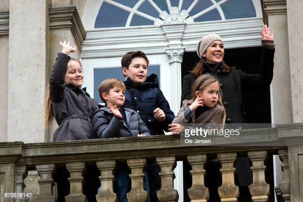 Crown Princess Mary and children waves to riders during the yearly Hubertus Hunt at The Woodland Park 'Dyrehaven' on November 5, 2017 in Klampenborg,...