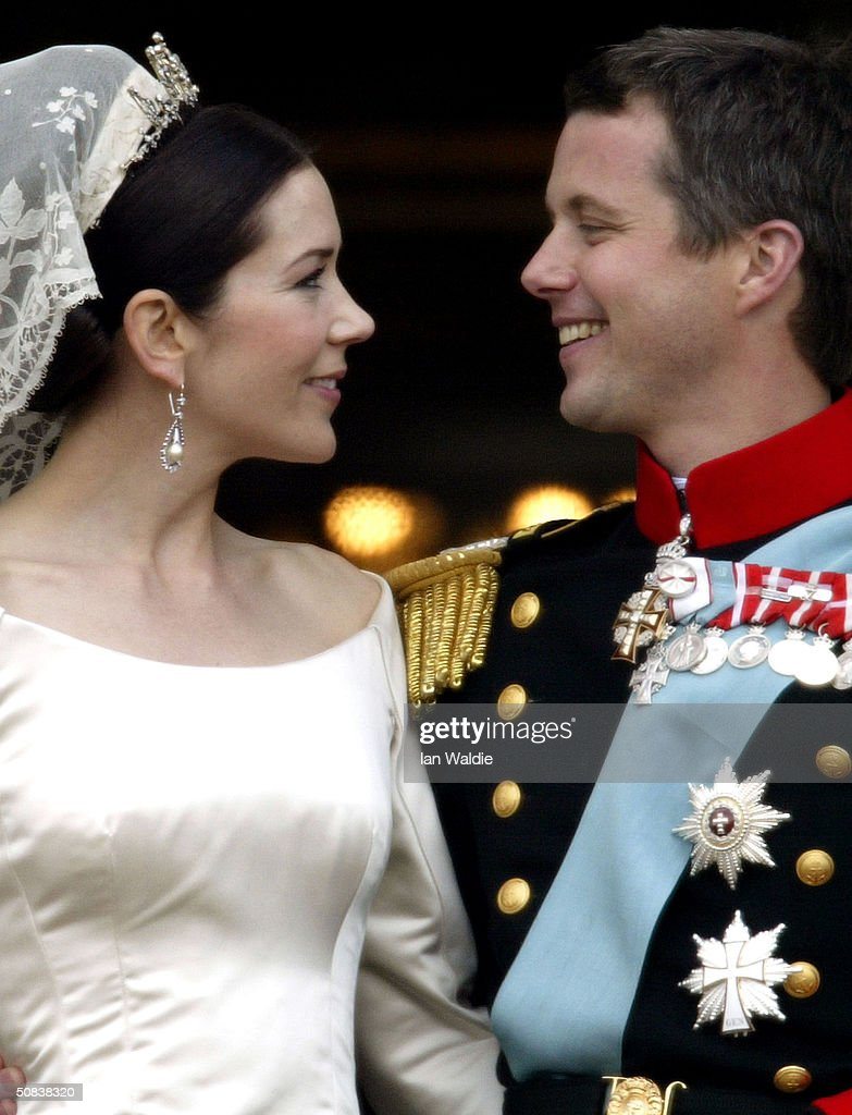Crown Princess Mary and Crown Prince Frederik look at each otheras the Royal couple appear on the balcony of Christian VII's Palace after their wedding on May 14, 2004 in Copenhagen, Denmark. The romance began in 2000 when Miss Mary Elizabeth Donaldson met the heir to one of Europe's oldest monarchies over drinks at the Sydney Olympics, where he was with the Danish sailing team.