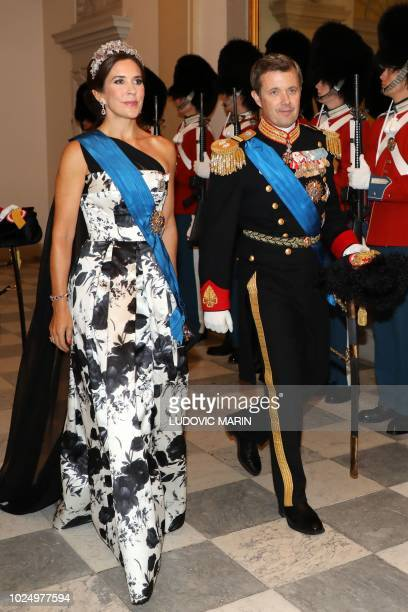 Crown Princess Mary and Crown Prince Frederik of Denmark arrive for the state dinner at Christiansborg Palace in Copenhagen on August 28 2018