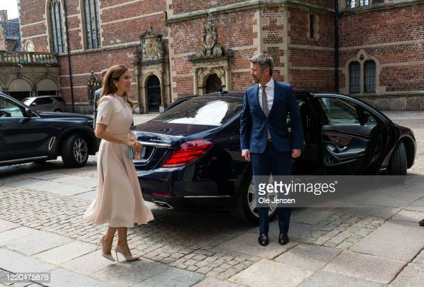 """Crown Princess Mary and Crown Prince Frederik of Denmark arrive to the exhibition opening of """"The Faces of the Queen"""" celebrating Queen Margrethe II..."""