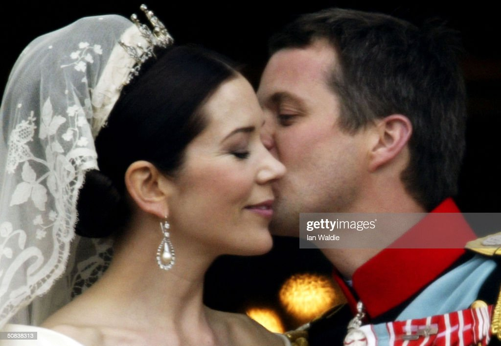 Crown Princess Mary and Crown Prince Frederik of Denmark kiss as the Royal couple appear on the balcony of Christian VII's Palace after their wedding on May 14, 2004 in Copenhagen, Denmark. The romance began in 2000 when Miss Mary Elizabeth Donaldson met the heir to one of Europe's oldest monarchies over drinks at the Sydney Olympics, where he was with the Danish sailing team.