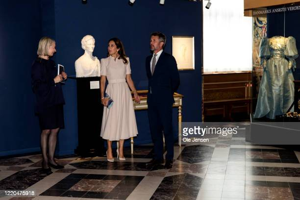"""Crown Princess Mary and Crown Prince Frederik of Denmark seen at the exhibition opening of """"The Faces of the Queen"""" celebrating Queen Margrethe II of..."""