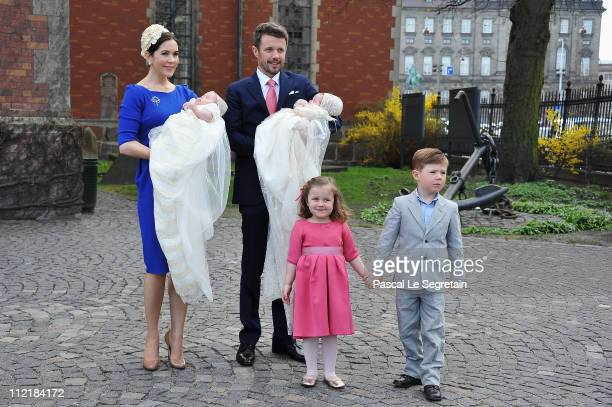 Crown Princess Mary and Crown Prince Frederik of Denmark with Princess Isabella and Prince Christian pose after the christening of their twins Prince...
