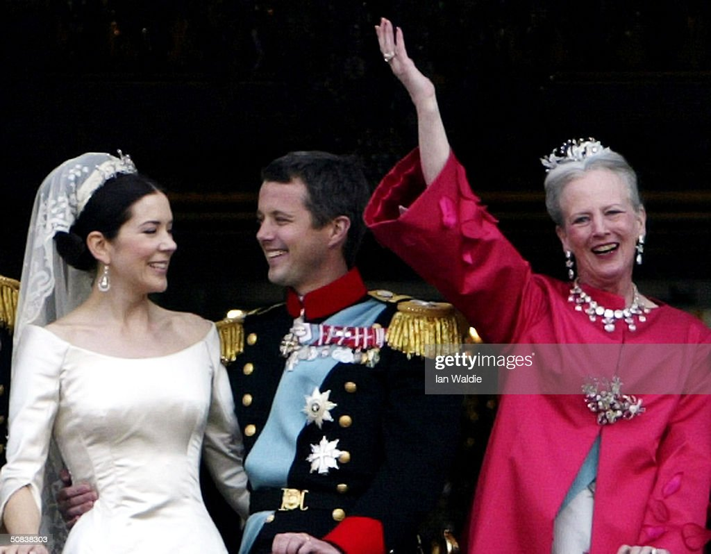 Crown Princess Mary and Crown Prince Frederik share a laugh as Queen Margrethe II of Denmark waves to the crowd as the Royal couple appear on the balcony of Christian VII's Palace after their wedding on May 14, 2004 in Copenhagen, Denmark. The romance began in 2000 when Miss Mary Elizabeth Donaldson met the heir to one of Europe's oldest monarchies over drinks at the Sydney Olympics, where he was with the Danish sailing team.