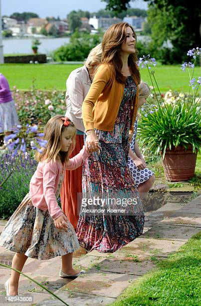 Crown Princess Mary and Princess Isabella pose during a photocall for the Royal Danish family at their summer residence of Grasten Slot on July 20...
