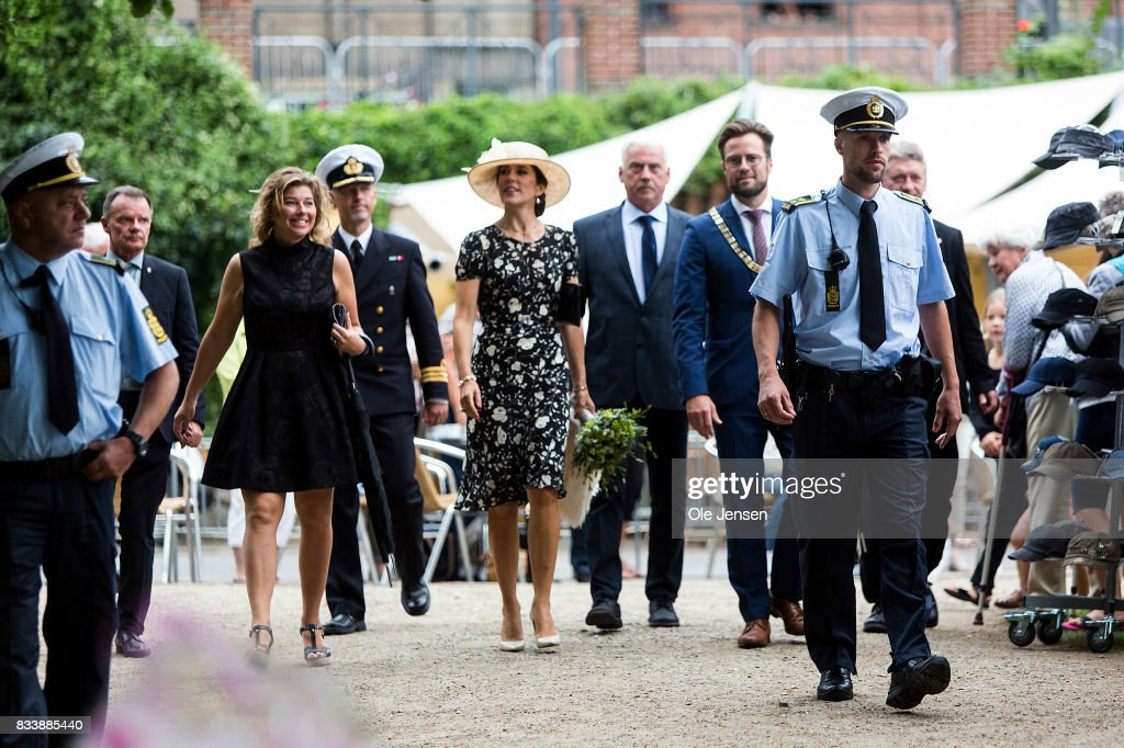 Crown Princess Mary (C) arrives to Odense Flower Festival which she is to open officially and where she is to be presented to a new developed rose on August 17, 2017 in Odense, Denmark. The Crown Princess is accompanied by festival responsible Henrietta Rasmussen (L) and mayor Peter Rhabaek (R). The festival opens today and ends August 20 and takes place all over the inner city with some 100.000 plants made up with the theme 'What a Woinderful World' and urban gardening.