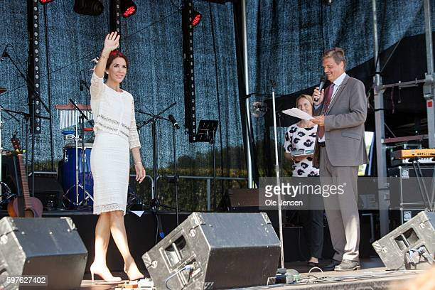 Crown Princess Mary at the stage together with mayor John Engelhardt during her visits to the city of Glostrup's 850 year anniversary in Denmark on...
