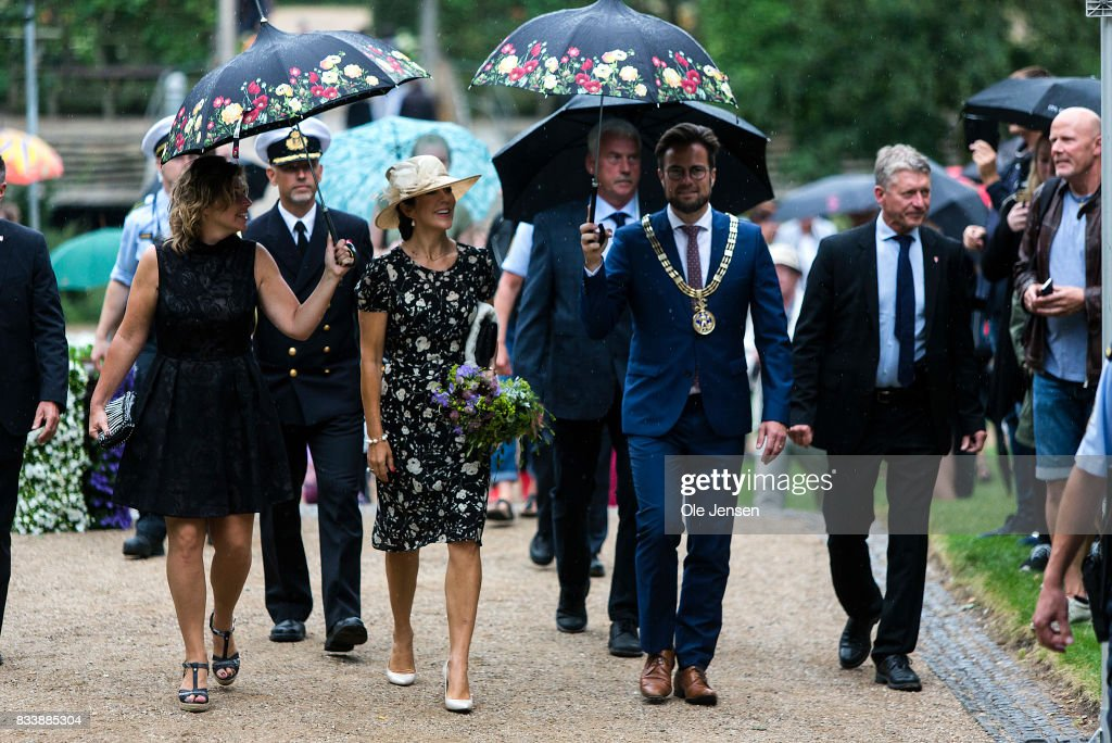 Crown Princess Mary (C) attends Odense Flower Festival which she is to open officially and where she is to be presented to a new developed rose on August 17, 2017 in Odense, Denmark. The Crown Princess is accompanied by festival responsible Henrietta Rasmussen (L) and mayor Peter Rhabaek (R). The festival opens today and ends August 20 and takes place all over the inner city with some 100.000 plants made up with the theme 'What a Woinderful World' and urban gardening.